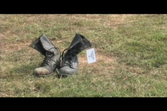 Medium-shot of a pair of combat boots symbolizing the loss of soldiers in the Stock Footage