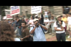Handheld-shot walking through a religious anti-war protest. Stock Footage