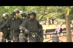 Riot police waiting in a park in Washington DC Stock Footage