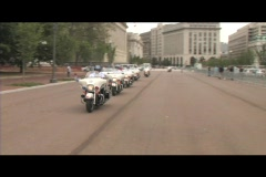 Following shot of motorcycle police-officers traveling down a Washington DC Stock Footage