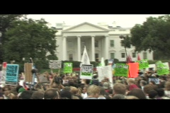 Medium-shot of anti-Iraq war protestors demonstrating in front of the White - stock footage