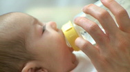 Infant Drinking from a Bottle (5 of 6) Stock Footage
