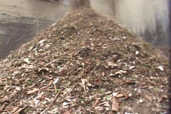 Debris pours into a pile at a recycling center. Stock Footage