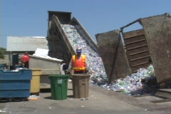 A conveyor belt moves thousands of plastic bottles at a Stock Footage