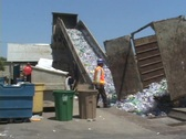 Stock Video Footage of A conveyor belt moves thousands of plastic bottles at a