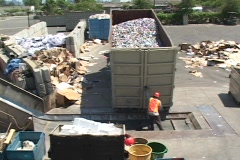 Workers unload aluminum cans at a recycling center. Stock Footage