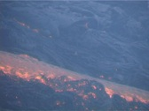 Lava flows down the side of a volcano. Stock Footage