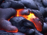 Cooling crust shows fiery hot molten lava underneath. Stock Footage