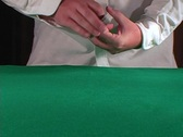A dealer in a casino shuffles cards and lays them out on a Stock Footage