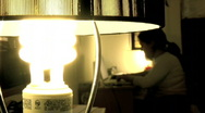 Energy Saver Bulb Turned On/Off Woman in Back Stock Footage