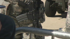 Machine gun on military security guard - stock footage