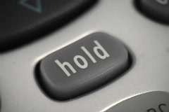 A close up shot of the hold button on a phone. Stock Footage