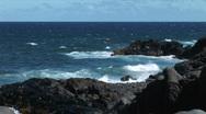 Waves crash on lava rock Stock Footage