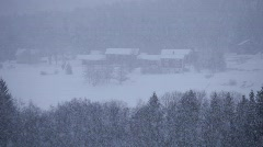 Snow falling on a village in Sweden Stock Footage