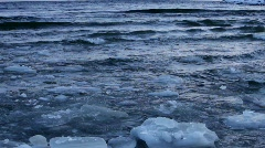 Ice floes floating and crashing against each other on ocean waves Stock Footage