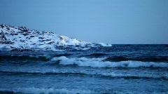 Ocean waves rolling in on a beach in winter Stock Footage
