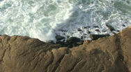 Stock Video Footage of Overhead Shot of Waves Crashing Against Rocky Coast – Time Lapse