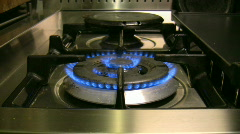 Burning stove in the kitchen 1 Stock Footage
