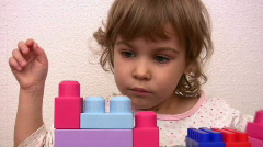 Little girl with toy cubes Stock Footage