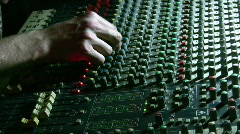 Hands on mixing sound board Stock Footage