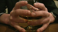 Fingers on cognac glass Stock Footage