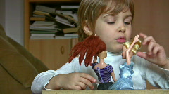 Little girl with dolls talk  stroke hairs Stock Footage