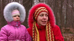 Mother with girl in fur clothes Stock Footage