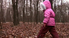 Walking little girl in winter park Stock Footage