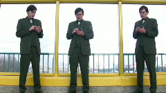 Three businessmen clones with pocket pc Stock Footage