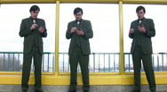 Stock Video Footage of three businessmen clones with pocket pc