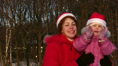 Mother with little girl christmas faces Stock Footage