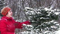 Woman and fur-tree in snow Stock Footage