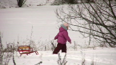 Little girl with sled Stock Footage