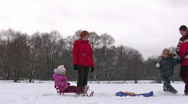 Family of four with sleds Stock Footage