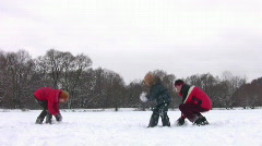 Family with boy playing snowball Stock Footage