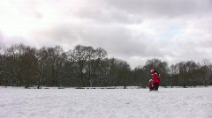 Family with little girl on sled Stock Footage