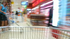 Pushcart goes to shop. Time lapse Stock Footage