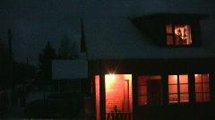 Light in window of house in night - stock footage