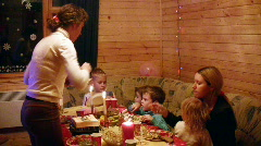 Two mothers with four children sit at festive table Stock Footage