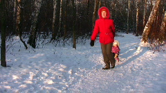 Mother with children on sled Stock Footage