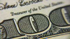 Numeral one hundred dollar bills macro rotating - stock footage