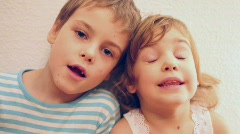 Brother with sister singing Stock Footage