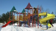 Family of four on winter playground  time lapse Stock Footage