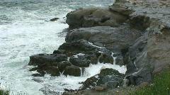 Waves Crashing onto Rocky Coastline in California Stock Footage