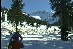 Snowy mountain against blue sky. - stock footage