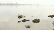 Girl throwing pebble in the water Stock Footage