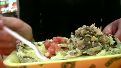 Female hands eat mashed potatoes mushrooms fish in fastfood Stock Footage