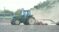 tractor cultivating a bare field - stock footage