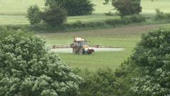 Crop sprayer Oxney Flatts Farm, L to R. - stock footage
