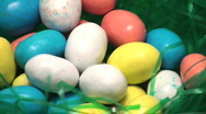 Stock Video Footage of Easter eggs candy in grass loop - HD